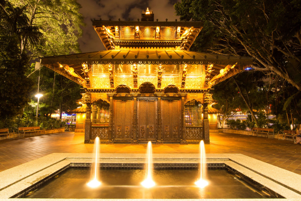 The Nepalese Peace Pagoda, South Bank Brisbane, is lit up in the evening and highlight the detail of the hand crafted structure.