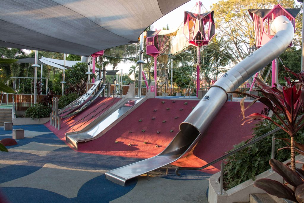 There are slides and a climbing wall at the Riverside Green Playground, South Bank, Brisbane.