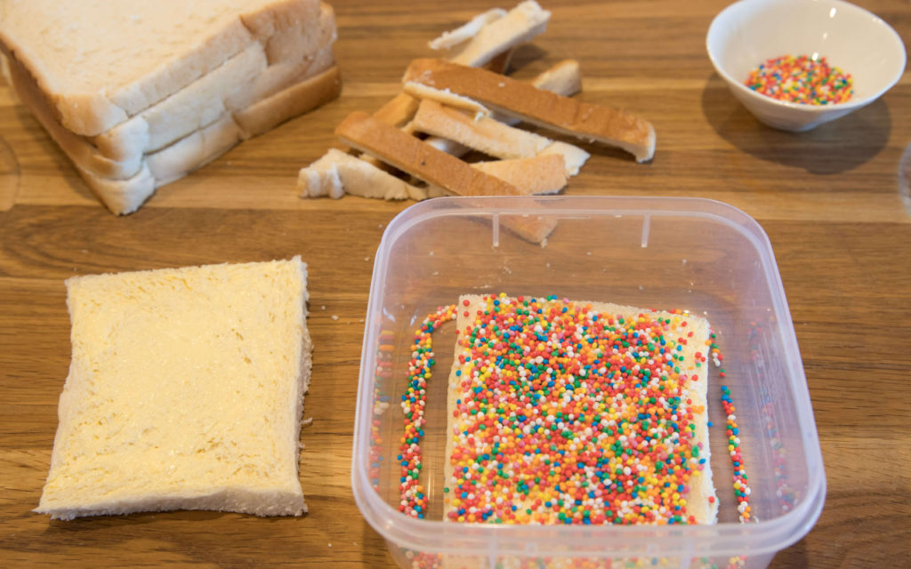 Making Fairy Bread for Fairy Bread Day can be a messy process.